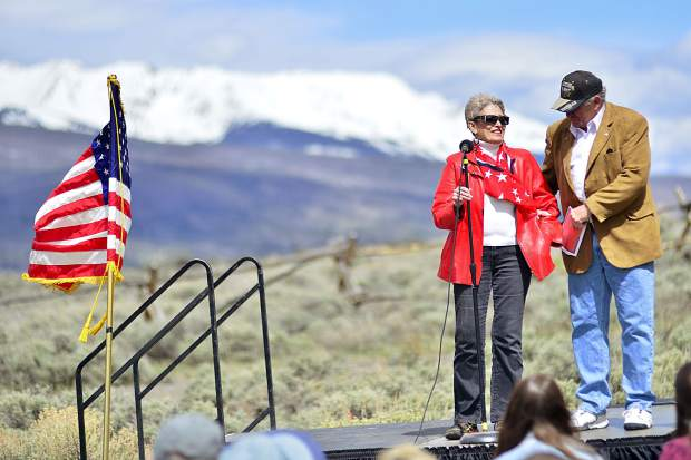 Lillian Bickel gets a hand of support as she speaks about her husband who went missing in action in the 1960s during Monday's Memorial Day ceremony at Dillon Cemetery. Bickel said her story is so long, she'll have to come back to finish it.