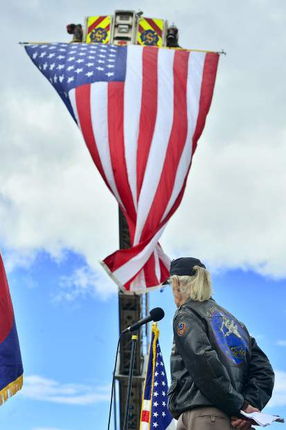 """Stuart """"Boot"""" Gordon exits the stage after speaking at Monday's Memorial Day ceremonies at Dillon Cemetery."""