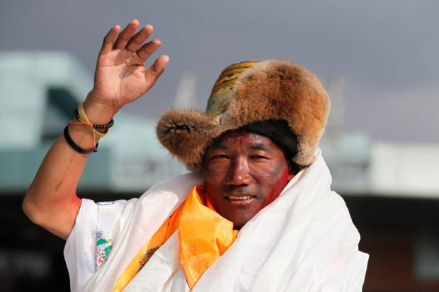 Nepalese veteran Sherpa guide, Kami Rita, 48, waves as he arrives in Kathmandu, Nepal in May 2018. Rita has scaled Mount Everest for a 23rd time, breaking his own record for the most successful ascents of the world's highest peak.