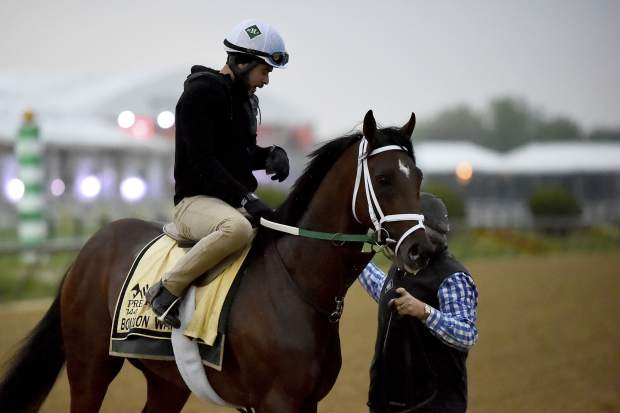 Preakness Stakes entrant Bourbon War is led off the track after exercising on Thursday at Pimlico Race Course in Baltimore.