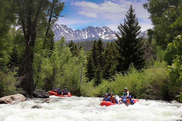 Performance Tours Rafting guides a whitewater trip down the Blue River in June 2018
