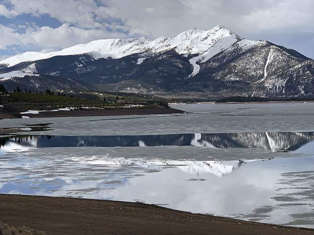 Peak 1 reflected in Dillon Reservoir between the ice and the still water on Monday.