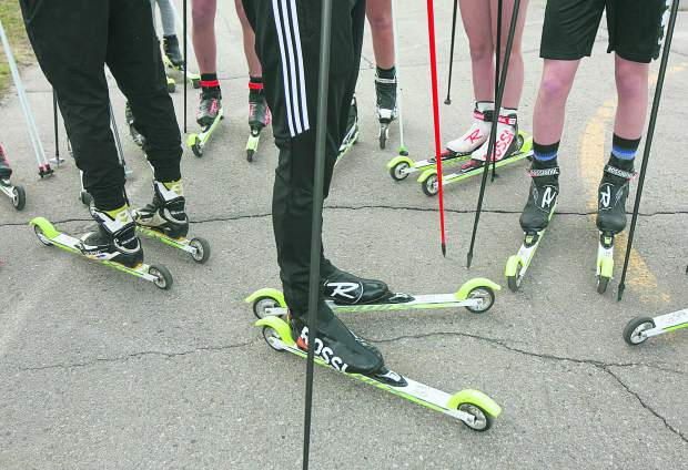 Members of the Summit Nordic Ski Club roller-ski on Tuesday, May 7, in Breckenridge.