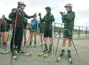 Summit youth Nordic skiers continue training in summer on roller-skis, pavement