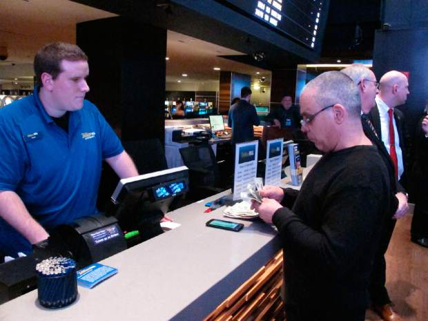 A gambler makes a sports bet at the Tropicana casino in Atlantic City, New Jersey on March 8. On Wednesday, Fox Sports announced it is buying nearly 5% of The Stars Group, the parent company of PokerStars, and that the two companies will offer sports betting in the fall in the U.S.