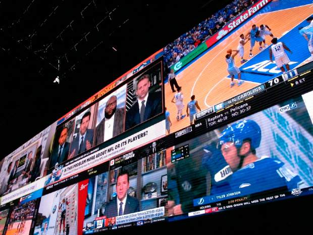 A wall of video screens are seen in the sports betting lounge at the Tropicana casino in Atlantic City, New Jersey on March 8. On May 8, Fox Sports announced it is buying nearly 5% of The Stars Group, the parent company of PokerStars, and that the two companies will offer sports betting in the fall in the U.S.