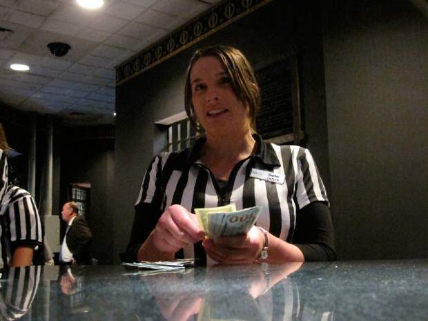 Heather Warker, an employee of the sports betting lounge at Bally's casino in Atlantic City, New Jersey counts money inside the teller's cage last July. On Wednesday, Fox Sports announced it is buying nearly 5% of The Stars Group, the parent company of PokerStars, and that the two companies will offer sports betting in the fall in the U.S.