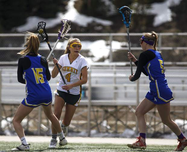 Summit High School girls lacrosse player Haley Davis possesses the ball against Roaring Fork players during the Tigers' 19-8 Senior Night loss on Thursday, May 2, at Tiger Stadium near Frisco. The Tigers finished the spring season with a 5-9 overall record.