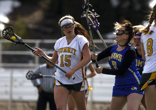 Summit High School girls lacrosse player Maison Keen possesses the ball against Roaring Fork players during the Tigers' 19-8 Senior Night loss on Thursday, May 2, at Tiger Stadium near Frisco. The Tigers finished the spring season with a 5-9 overall record.
