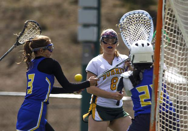 Summit High School girls lacrosse player Annika Fowles goes after a loose ball against Roaring Fork players during the Tigers' 19-8 Senior Night loss on Thursday, May 2, at Tiger Stadium near Frisco. The Tigers finished the spring season with a 5-9 overall record.