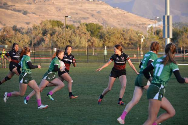 Summit Tigers rugby star Clara Copley runs with the ball versus United of Utah at the Pink 7s tournament in Utah last autumn, her teammates pictured include Nicole Kimball (far left) and Heidi Anderson (second from right) and P.K. Vincze (far right).