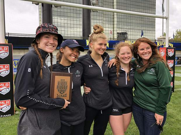 Members of the Summit Tigers High School Girls Rugby program pose for a photograph with their third-place plaque at the 2019 Girls High School Rugby National Championships at Infinity Park in Glendale on Sunday.