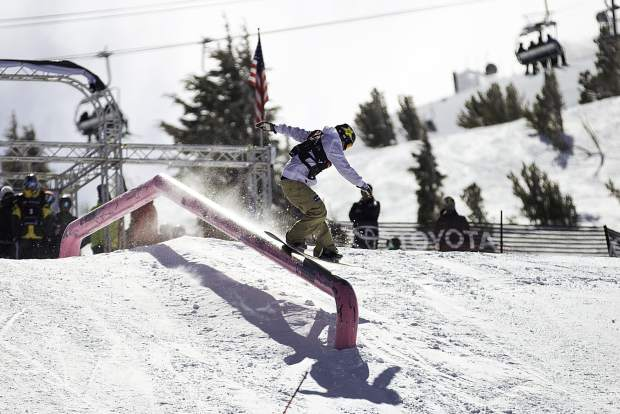 Chris Corning of Silverthorne executes a trick on a slopestyle rail during qualifiers earlier this winter at the Toyota U.S. Grand Prix at Mammoth Mountain Resort in California.