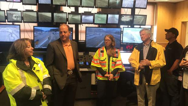 Governor Polis signs new traction, snowplow laws outside Eisenhower Tunnel