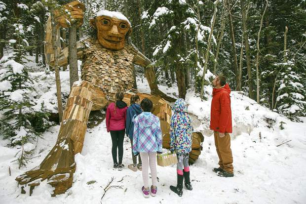 Troll creator Thomas Dambo and local girls, Tori Garner, Lexi Garner, Jade Batdorff, and Paige Batdorff, in front of Isak Heartstone, Friday, May 10, in Breckenridge.