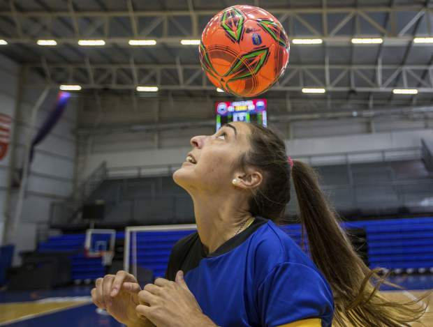 Macarena Sanchez, a soccer player who is taking legal action against her club and the Argentine soccer association for not recognizing her as a professional player, heads a ball before a mixed soccer match as part of the