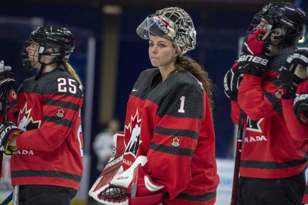 Canada goaltender Shannon Szabados watch as U.S. players celebrate a win during the Four Nations Cup hockey gold-medal game in Saskatoon, Saskatchewan.