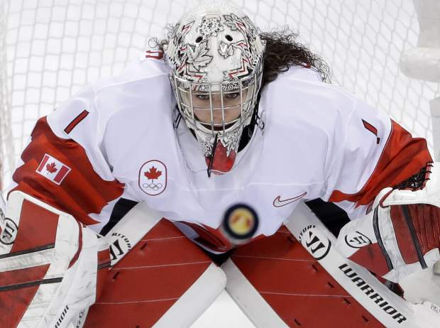 Goalie Shannon Szabados (1), of Canada, stares at the flying puck during the second period of the women's gold medal hockey game against the United States at the 2018 Winter Olympics in Gangneung, South Korea.