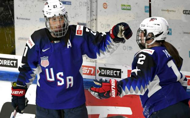 Team USA's Hilary Knight, left, celebrates a goal with Kelly Pannek, who provided the assist, during a IIHF Women's Ice Hockey World Championships semifinal match against Russia, in Espoo, Finland. More than 200 of the top female hockey players in the world have decided they will not play professionally in North America next season, hoping their stand leads to a single economically sustainable league.