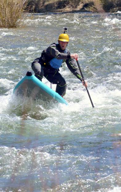 Summit local Ben Staley trains on the Blue River just outside of Silverthorne for the 2016 GoPro Mountain Games in Vail. A simple sequence can improve balance for stand-up paddleboarding on whitewater.