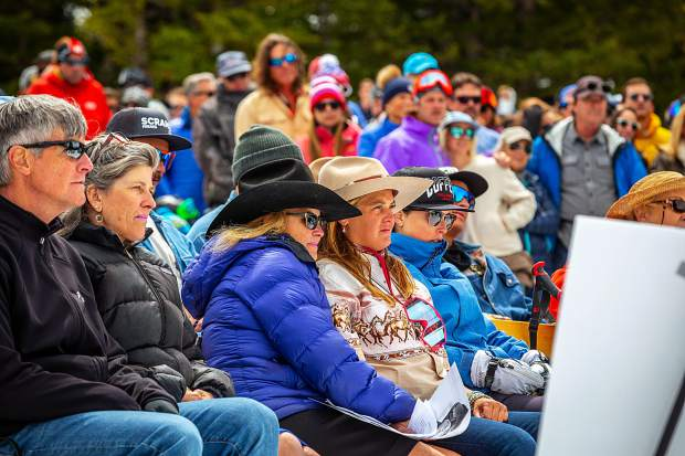 Sam Coffey's friends and family look on Monday as speakers celebrate Sam Coffey's life at a memorial service on Aspen Mountain.