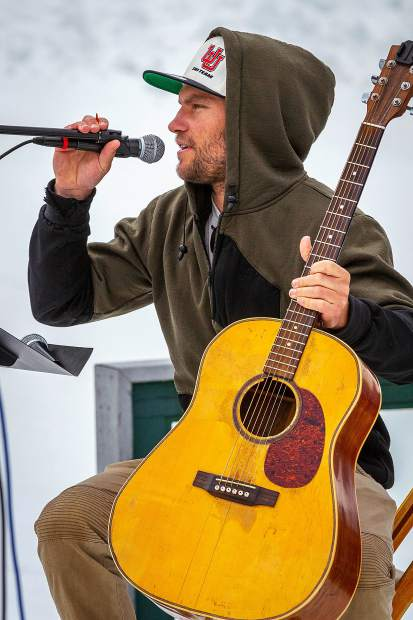 Ski racer and musician Mark Engel dedicates a song to Sam Coffey at a memorial service Monday held on Richmond Ridge.