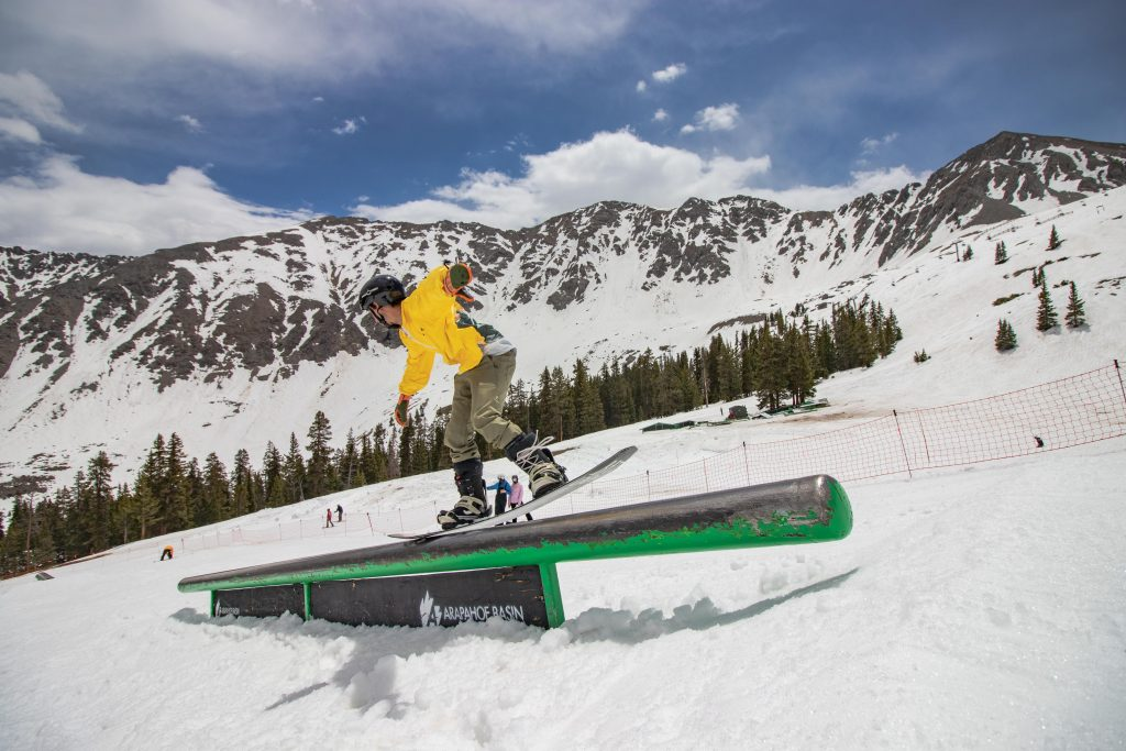 A snowboarder executes a trick on a rail while riding through the Treeline terrain park at Arapahoe Basin Ski Area last month.