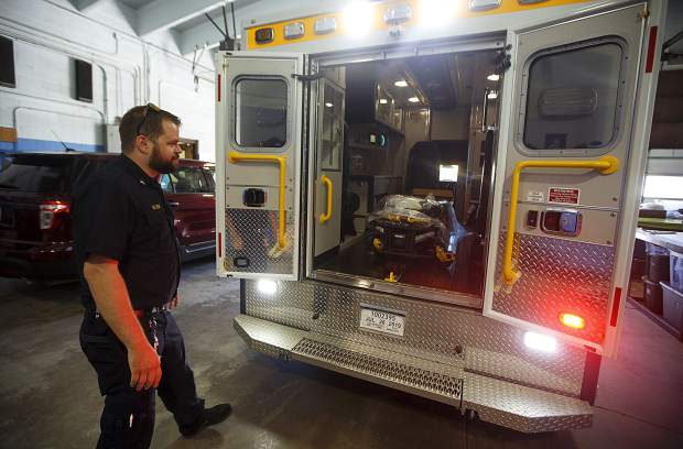 Summit Fire and EMS Paramedic Supervisor Austin Wingate describes the features of the new ambulance at the fire station Wednesday, June 12, at Station 10 in Silverthorne.
