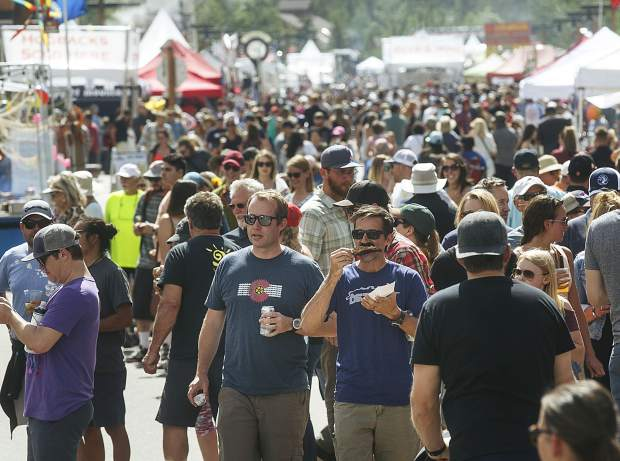 People pack Frisco's Main Street during the Colorado BBQ Challenge on Friday, June 15, 2018.