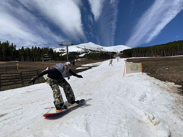 A snowboarder lets out a scream of elation at the base of the groomed skiing and riding run Breckenridge Ski Resort constructed leading into the Peak 7 Independence SuperChair during Sunday's closing day of the extended 2018-19 winter season. At rear, the top of the resort's Peak 8 terrain is in view, terrain that was available for skiing and riding from the top of the Imperial Express SuperChair on Sunday. Breckenridge will begin operating its BreckConnect Gondola from downtown to the base of Peak 8 on Friday, the start of the resort's summer operations -- just five days after the resort closed for