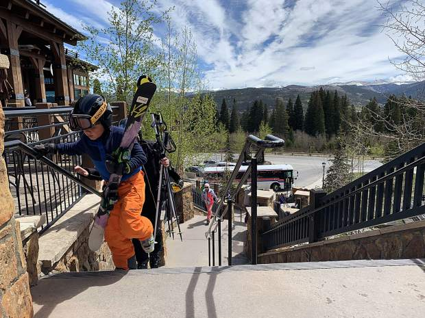 A young skier takes the final step to the base area of the Independence SuperChair on Sunday during Breckenridge Ski Resort's closing day for the extended 2018-19 winter season. All skiers and snowboarders heading to the mountain from downtown boarded free buses provided by the resort in recent weeks as the BreckConnect Gondola was not operable due to public land management regulations intended to protect sensitive forest areas and wildlife. Breckenridge will begin operating its BreckConnect Gondola from downtown to the base of Peak 8 on Friday, the start of the resort's summer operations -- just five days after the resort closed for