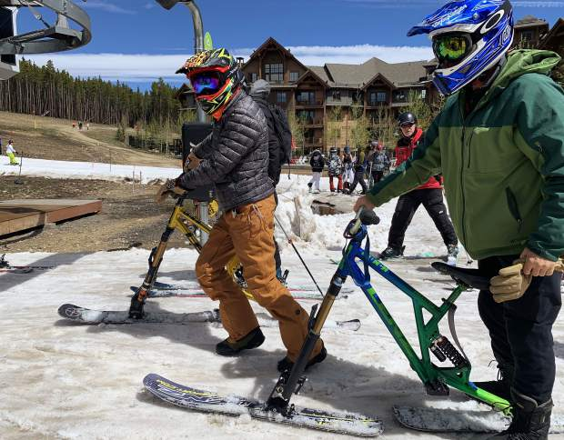 Snow bikers prepare to load the Independence SuperChair at the base of Breckenridge Ski Resort's Peak 7 during Sunday's closing day of the extended 2018-19 winter season. Breckenridge will begin operating its BreckConnect Gondola from downtown to the base of Peak 8 on Friday, the start of the resort's summer operations -- just five days after the resort closed for