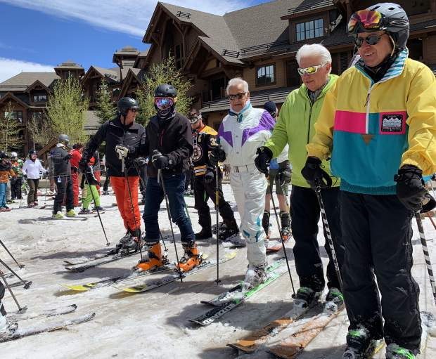 Breckenridge Ski Resort founder Trygve Berge (center) and Breckenridge Ski Resort friends prepare to load the Independence SuperChair at the base of Breckenridge Ski Resort's Peak 7 during Sunday's closing day of the extended 2018-19 winter season. Breckenridge will begin operating its BreckConnect Gondola from downtown to the base of Peak 8 on Friday, the start of the resort's summer operations -- just five days after the resort closed for