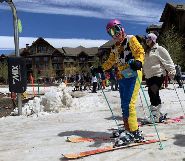 A skier dressed in Toy Story garb prepares to load the Independence SuperChair at the base of Breckenridge Ski Resort's Peak 7 during Sunday's closing day of the extended 2018-19 winter season. Breckenridge will begin operating its BreckConnect Gondola from downtown to the base of Peak 8 on Friday, the start of the resort's summer operations -- just five days after the resort closed for