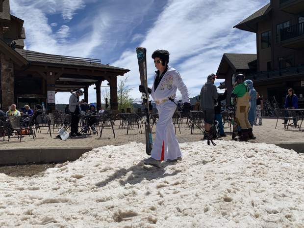 Elvis has entered the base area. A skier donned in an outfit in honor of the King of Rock and Roll walks with skis in hand over the slushy snow at the base of Breckenridge Ski Resort's Peak 7 Independence SuperChair during Sunday's closing day of the extended 2018-19 winter season. Breckenridge will begin operating its BreckConnect Gondola from downtown to the base of Peak 8 on Friday, the start of the resort's summer operations -- just five days after the resort closed for