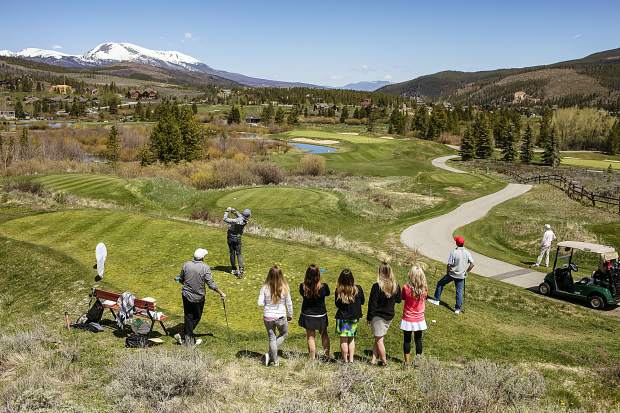 Golfers spot the path of a tee shot during last weekend's Breckenridge Grand Vacations Annual Golf Tournament to benefit The Summit Foundation, Buffalo Mountain in view in the distance.