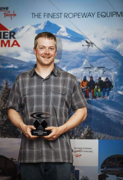 Arapahoe Basin Ski Area ski patroller Scott Bickel takes a photo accepting his Ski Patroller of the Year Award at last week's 56th annual Colorado Ski Country USA meeting and Double Diamond Awards banquet at the JW Marriott Hotel Cherry Creek in Denver.