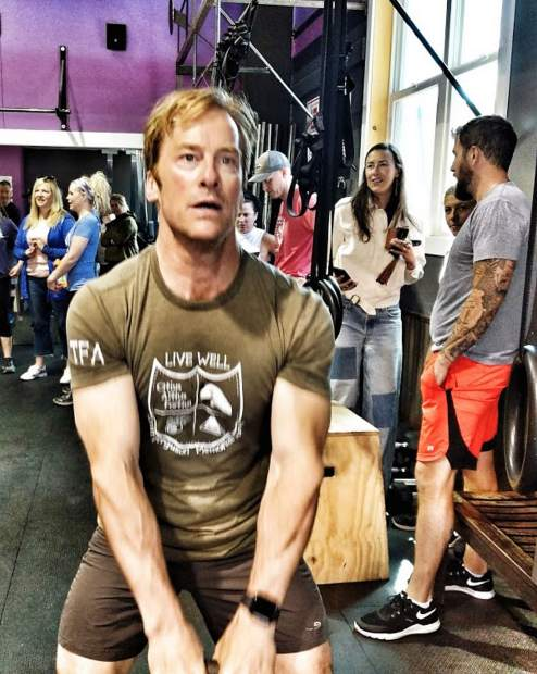 "John Rath swings a kettlebell as he does the ""Coach Fergs"" workout on June 1 at CrossFit Breckenridge, created in honor of the gym's founder, Scott Ferguson."