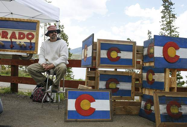 Colorado Woodcraft artist Steve, who declined to give out last name, sits at his booth during the Dillon Farmers Market Friday, June 7, in Dillon.