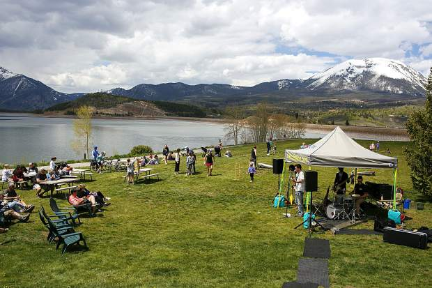 People enjoy live music on the waterfront Friday, June 7, in Dillon.