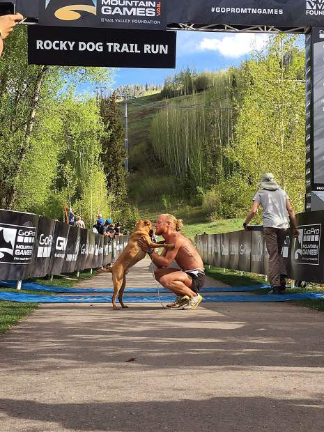 Anthony Kunkel won the men's division of the Rocky Dog Trail Run on Thursday at the GoPro Mountain Games with his dog Winston.