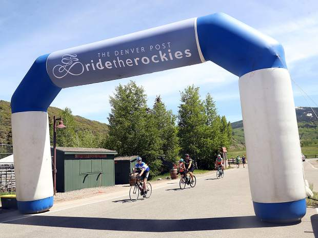 Cyclists cross the finish line on Day 3 of Ride the Rockies on Tuesday, June 11, 2019, near the Rodeo Lot in Snowmass Village.