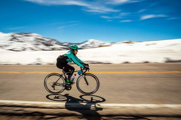 A cyclist makes her way over Independence Pass after climbing up the Twin Lakes side on day three of Ride the Rockies Tuesday.
