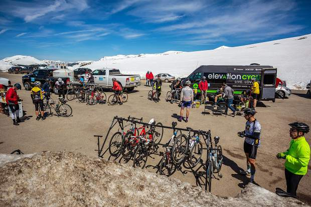 Cyclists take a break after climbing up the Twin Lakes side of Independence Pass on the third day of Ride the Rockies Tuesday.