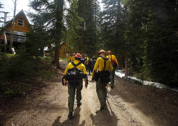 Summit Fire and EMS wildland firefighters get familiar with the homes located along Boulder Creek during training Thursday June 20, near Silverthorne.