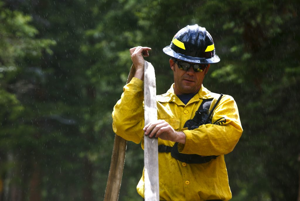 Summit Fire and EMS wildland firefighter Rob Beesley wraps up the fire house following a training session Thursday June 20, along Boulder Creek near Silverthorne.