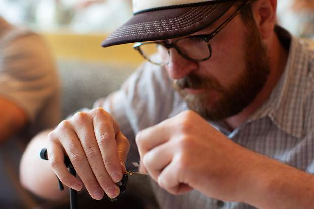 Chris Hartman works on tying a nymph during the first round of the Fly Tying Competition on Friday at the GoPro Mountain Games.