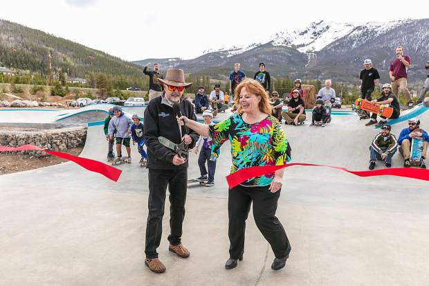 Skateboarders look on as Frisco Mayor Gary Wilkinson cuts the ribbon to signify the official grand opening of the town's new skatepark on June 4, the twin peaks of Peak One and Tenmile Peak in view in the distance.