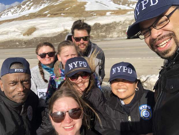 My family, including my twin sister Annie (front), my mother Eileen (center) and my younger sisters Alexis (behind my mother) and Kelsey (second from left) join me (rear) in posing for a photo with three members of the New York City Police Department in a surreal east-meets-west moment for native New Yorkers at Loveland Pass in late April.