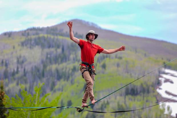 Logan O'Brien, of Lyons, competes in the Highline Speed Walk competition for the GoPro Mountain Games on Friday in Vail. The competition saw athletes walking 50 feet in the air, as fast as possible.
